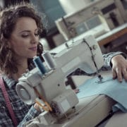 Young woman sewing on a sewing machine