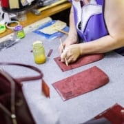 woman sewing bags